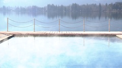 Pool at lakeshore in the morning haze Stock Footage