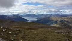 Panning view from a mountain ridge in the Scottish Highlands. Stock Footage