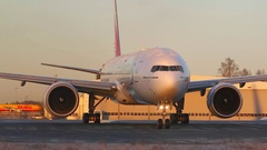 Huge airplane taxiing right to left behind obstacle Stock Footage