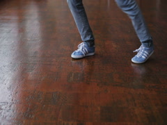 Female feet dancing breakdance on the dance floor, Close-up shot of dancing feet Stock Footage