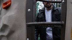 Man attempting to lure child away from playground Stock Footage