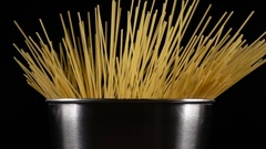 Bunch of spaghetti falls in a pot Stock Footage