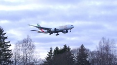 Emirates skycargo airplane arriving airport flying left to right Stock Footage