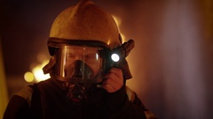 Building is on Fire. Brave Fully Equipped Firefighters Takes off His Helmet. Stock Footage