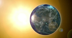 Earth Rotating 360 degrees. Yellow Sun and Stars Background. Loop-ready. Stock Footage