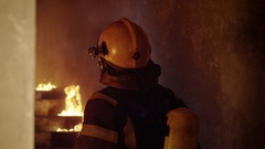 Portrait of a Brave Firefighter Inspecting Burning Building.  Stock Footage