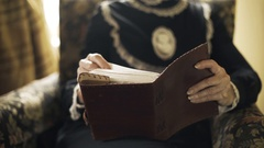 Victorian era woman reading a book or bible closeup 4k Stock Footage