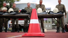 Red protective cone on background of firefighters Stock Footage