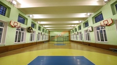 The light turns off in an empty spacious sports hall for basketball Stock Footage