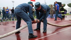Workers disconnect fire hose with water during the Moscow City Championship Stock Footage