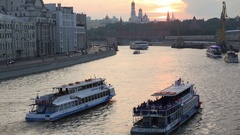 Pleasure boats on the Moskva River and the Kremlin at sunset Stock Footage