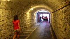 People go through a narrow tunnel in Loano Stock Footage