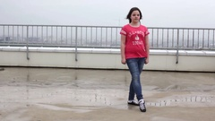 Girl dancing the national Irish dance on the roof on a cloudy day Stock Footage