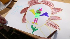 The child draws picture dedicated to protecting environment with markers Stock Footage