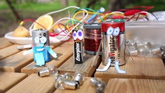 Three batteries Navigator, Energizer and Osel with hands and eyes on able Stock Footage