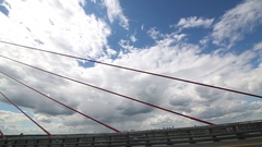 Ropes on the bridge on a background of bright blue sky with clouds Stock Footage