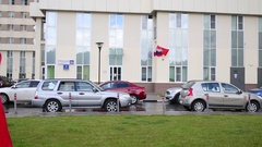 Russian flag hung on a drone DJI Phantom that flies in the courtyard Stock Footage