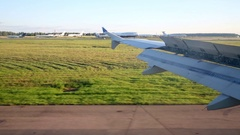Aircraft brakes on the landing strip at airport using mechanisms of wing Stock Footage