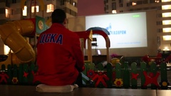 A man in a jacket with an inscription CSKA cheer for the national team Stock Footage