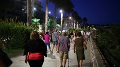 Evening promenade filled with people in the evening Stock Footage