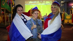 Women posing in Russian flags and cheer for the national team at Euro 2016 Stock Footage