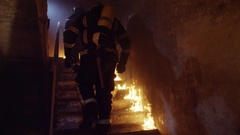 Two Strong Firefighters Going Up The Stairs in Burning Building.  Stock Footage