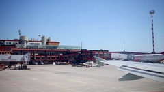 Planes stand in front of the Genoa Cristoforo Colombo Airport Stock Footage