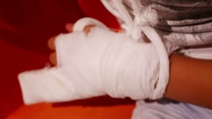 Hand of the boy with two fingers bandaged in plaster Stock Footage