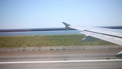 View from the window of the plane at the time of take-off in Genoa, Italy Stock Footage