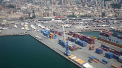 Lot of freight containers in the port of city from the airplane window Stock Footage