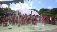 People having fun in jets of fountain in water park Le Caravelle. Stock Footage