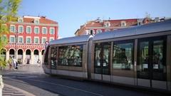 Tram rides through Massena square Stock Footage