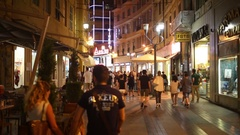 People walk on a pedestrian street Via Giacomo Matteotti at the evening Stock Footage