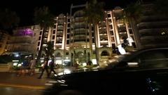 Movement on the Boulevard de La Croisette at night Stock Footage