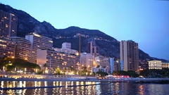 Evening cityscape with buildings on the seafront and mountains in Monaco Stock Footage