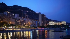 Night cityscape with buildings on the seafront in Monte Carlo, Monaco Stock Footage