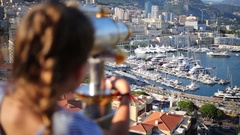 Port Hercule, the view from behind girls on the lookout in Monaco Stock Footage