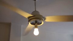 Ceiling fan in a room with white ceilings and walls Stock Footage