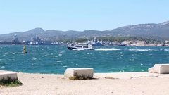 Boat passes the moored warships on the coast in Toulon, France Stock Footage