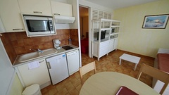 Kitchen with appliances, table and wash basin in the Hotel Les Agapanthes Stock Footage