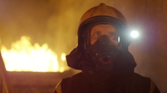 Portrait Shot of a Brave Fireman Standing in a Burning Building Fire Raging  Stock Footage