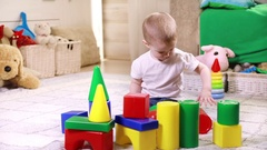 Little boy playing with plastic blocks Stock Footage