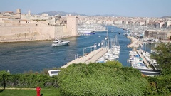 Boats and yachts moored in the old port near Saint Jean Castle in Marseille.. Stock Footage