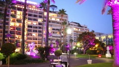 Building of the Grand hotel and a park with palm trees in its yard on a sum.. Stock Footage