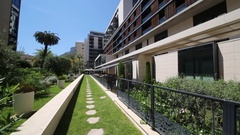 Path covered with grass and with plants on sides at the Hotel Novotel Monte.. Stock Footage