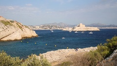 Rocky shore, cliffs and the island with Castle If near Marseille, France Stock Footage