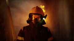 Portrait of a Brave Firefighter Standing in a Burning Building. Raging Fire  Stock Footage