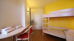 Small bedroom with a bunk bed in the Hotel Les Agapanthes Stock Footage
