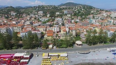 Bordighera, Italy,Town panorama with sea beach and church of Holy Land Stock Footage