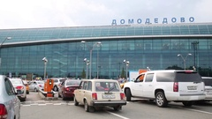 Cars driving through a checkpoint at the Domodedovo airport Stock Footage